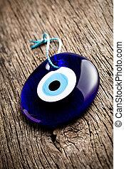 turkish eye - glass turkish eye on wooden background
