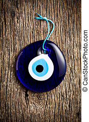turkish eye - glass turkish eye on wooden background