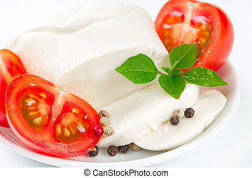 Mozzarella, tomatoes and basil leaves