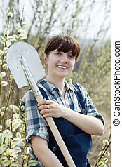 Happy   woman   with shovel