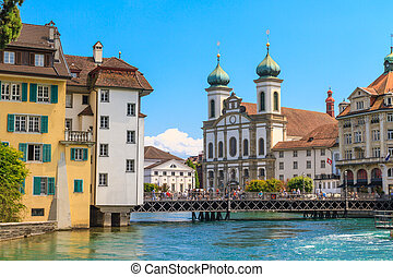 Lucerne city view with river Reuss and Jesuit church,...