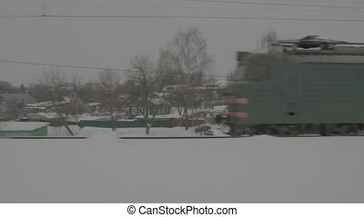 Trains on snowy rail way, close-up
