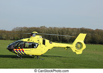 Rescue helicopter - First aid helicopter landed in a meadow...