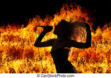 Female rock singer over blazing flames explosion background
