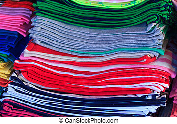 close up of a pile of tshirts at the market