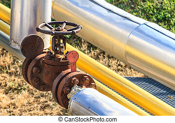 Industrial valve in petrochemical plant (close up)