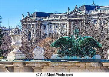 Vienna, Austria - Entrance portal of Burggarten with Hofburg Palace in background