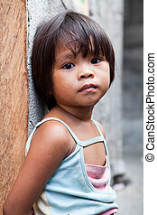 Philippines - young girl against wall - Adorable young girl...