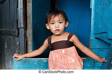 Young girl living in poverty - Adorable young girl living in...