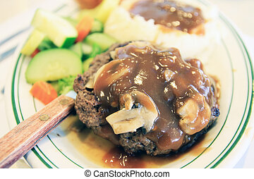 Meat with mushroom sauce - A dish of meat in mushroom sauce