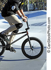 BMX jump - A young guy with his bmx bike