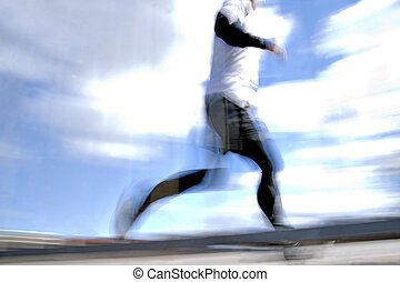 jogger in blurred motion - low angle view of jogger in...