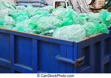 Recycling dumpster - Dumpster container with green bags for...