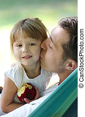 father with his small daughter in a hammock - young father...