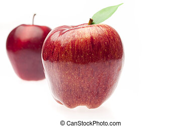 apples with green leaves isolated on white