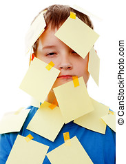 boy with memo posts on his face  on a white background