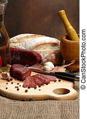 salami sausage - Close up of salami sausage on kitchen table