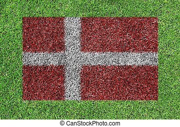 Denmark flag as a paining on green grass