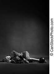 mime prisoner over dark background - portrait of mime...