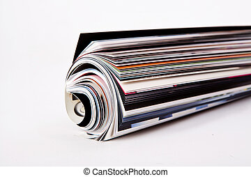 roll of magazine  - Roll of magazine on white backgound