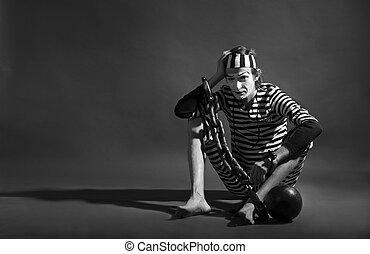 mime prisoner over dark background - portrait of mime...