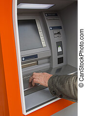 Banking cash at atm - Man at ATM or cash dispenser and...