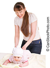 Mother changing babies cloth diaper.
