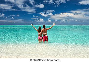 Couple on a beach at Maldives - Couple on a tropical beach...