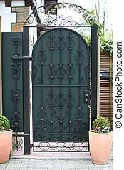 Ornate green metal entry gate