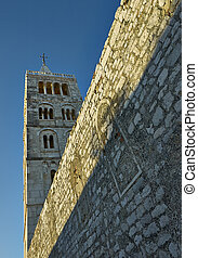 Bell tower in morning light - Bell tower and wall in island...