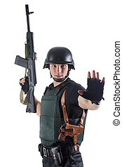 Police officer in body armour is holding a gun. Isolated on...