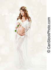 Pregnant woman. Beautiful pregnancy: long curly hair and...
