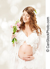 Pregnant woman Beautiful pregnancy: long curly hair and...