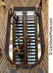 elevators in motion, blured people, photo taken in queen...