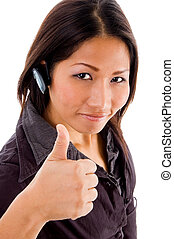 young female service provider with thumbs up wearing hands...