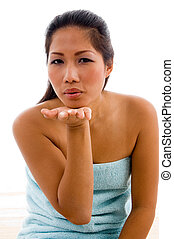lovely female model posing with flying kiss on an isolated...