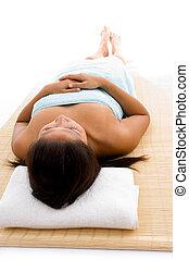 laying woman ready to take massage