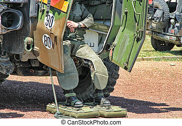 Bomb Squad (Deminage) - Young male soldier in bomb suit in...