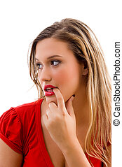 woman biting her finger and looking sideways on an isolated...