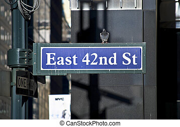 East 42nd St - A classic New York City street sign with a...