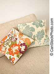 Floral cushions - Two decorative floral cushions arranged on...