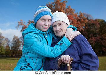 Grandmother and granddaughter for a walk.