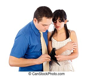 Money problems - Young couple looking at their empty purse.