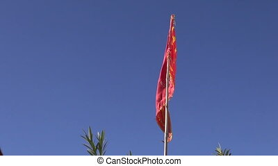 hindu temple flag on sky background and wind
