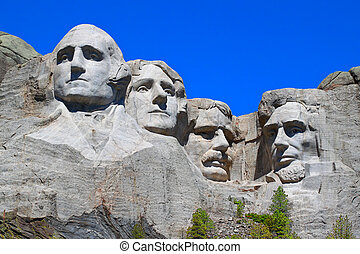 Mount Rushmore National Memorial carved into the peaks of...