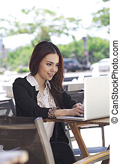 Asian businesswoman with laptop - Portrait of businesswoman...