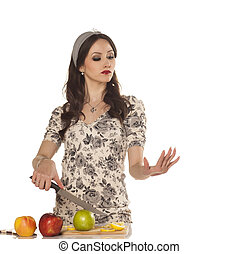 modern housewife cutting an apple and take care of her nails