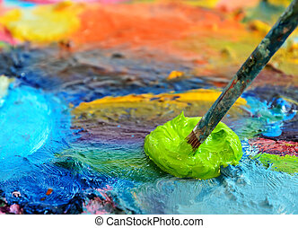 palette - Palette with paint and paintbrush, shallow depth...