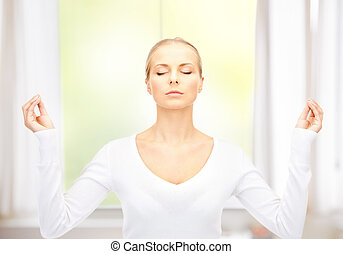beautiful woman in meditation - bright picture of beautiful...