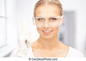 woman in protective glasses and gloves - picture of woman in...